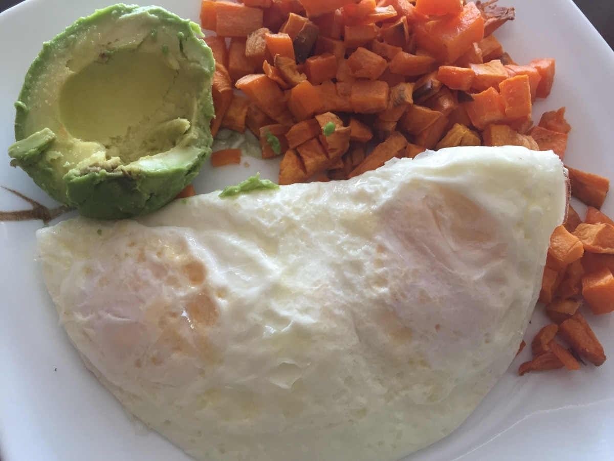 Pair your paleo roasted, diced sweet potatoes with a simple protein and fat like a few fried eggs and avocado.
